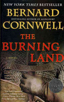 "<a href=""http://""https://amzn.to/3asWMRo"" https://www.amazon.com/Burning-Land-Novel-Saxon-Tales/dp/0060888768%3FSubscriptionId%3DAKIAJ2PCDIRRY6BU4NFA%26tag%3Dthebookreport01%26linkCode%3Dxm2%26camp%3D2025%26creative%3D165953%26creativeASIN%3D0060888768#:~:text=https%3A//amzn.to/3asWMRo"">The Burning Land</a> Book Cover"