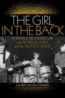 The Girl In The Back : punk rock revolution explodes around her,...