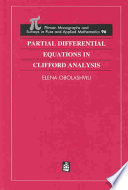 Partial Differential Equations in Clifford Analysis