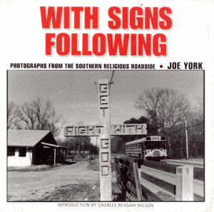 With signs following
