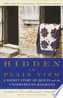 link to Hidden in plain view : the secret story of quilts and the underground railroad in the TCC library catalog