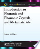 Introduction to Photonic and Phononic Crystals and Metamaterials