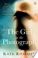 The Girl in the Photograph Book