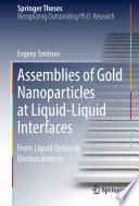 Assemblies of Gold Nanoparticles at Liquid Liquid Interfaces